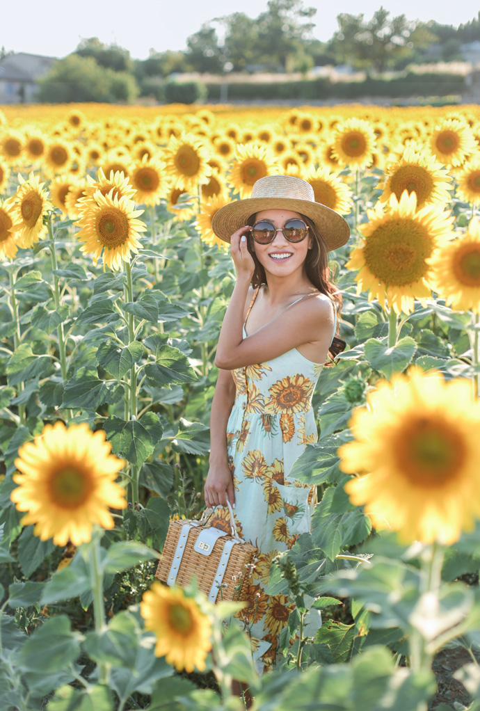 round retro sunglasses milly wicker bag summer outfit ideas sunflower field