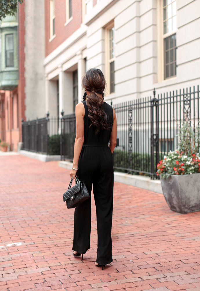stylish black jumpsuit wedding guest outfit