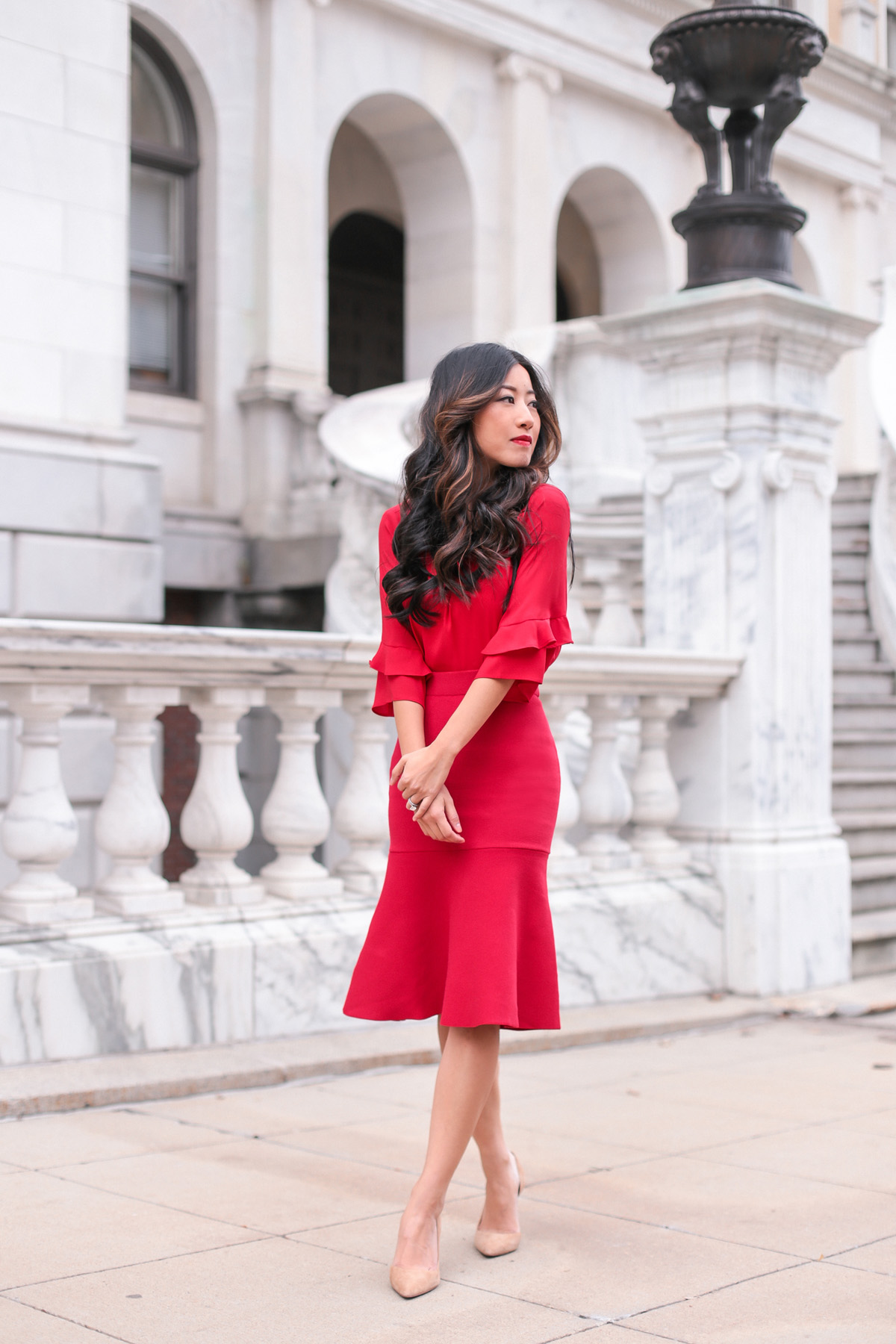 lady in red holiday outfit petite fashion blog