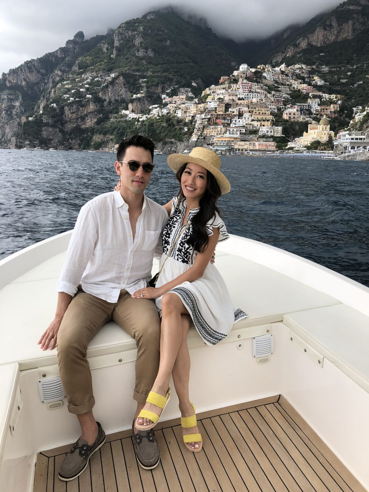 boat ride on positano amalfi coast italy couple trip