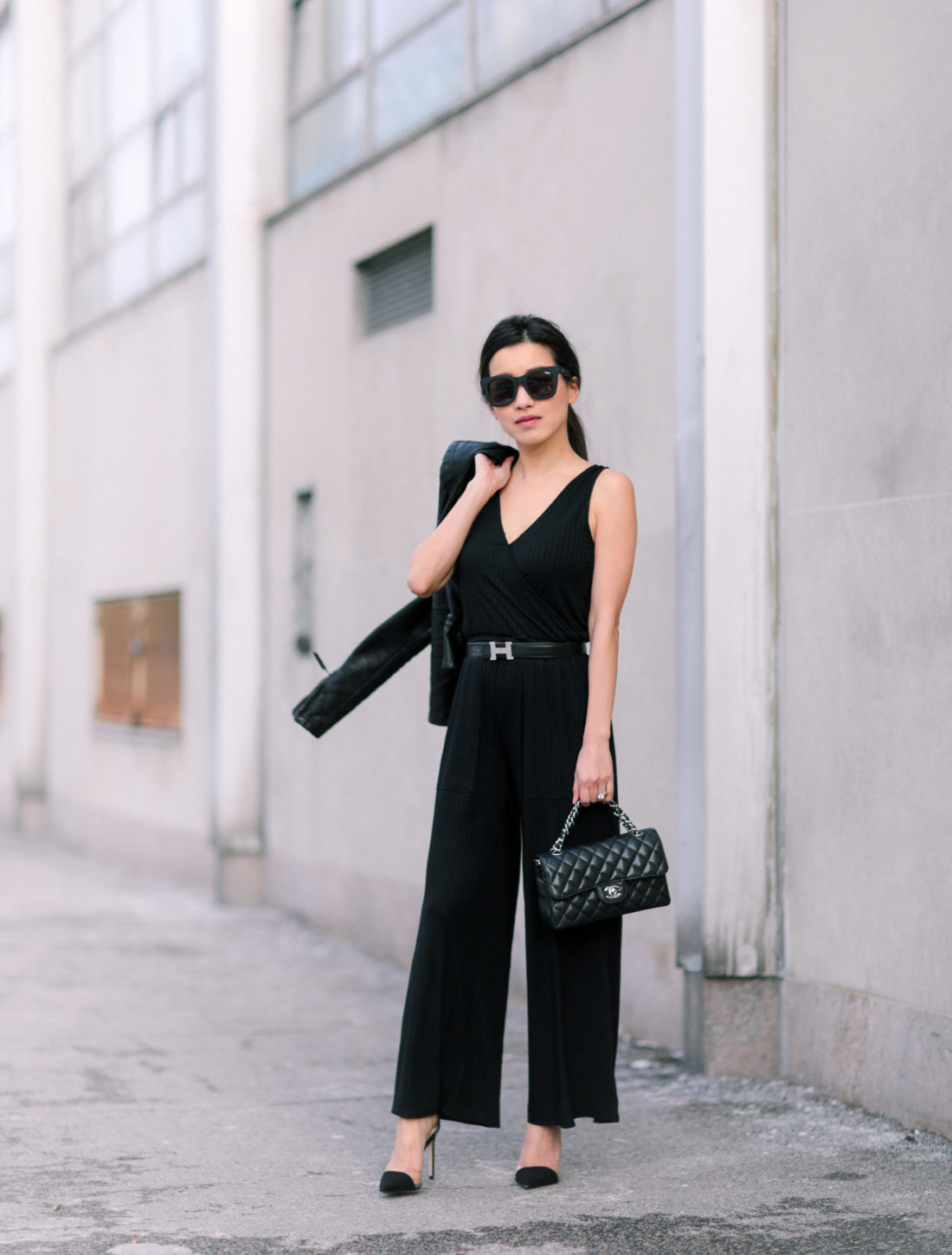 black jumpsuit chanel bag dressy outfit