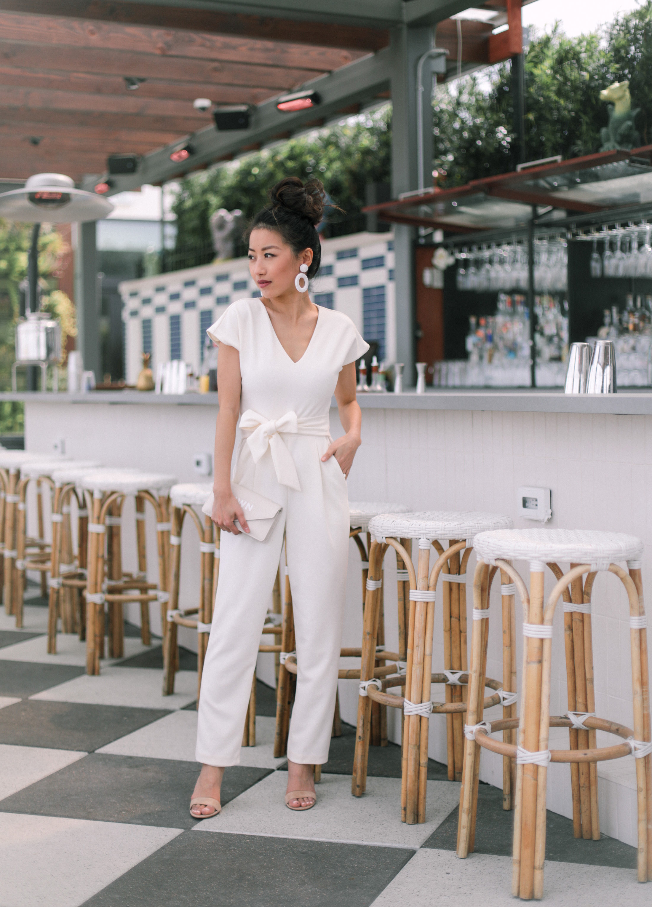 petite white jumpsuit outfit rehearsal dinner bridal shower outfit