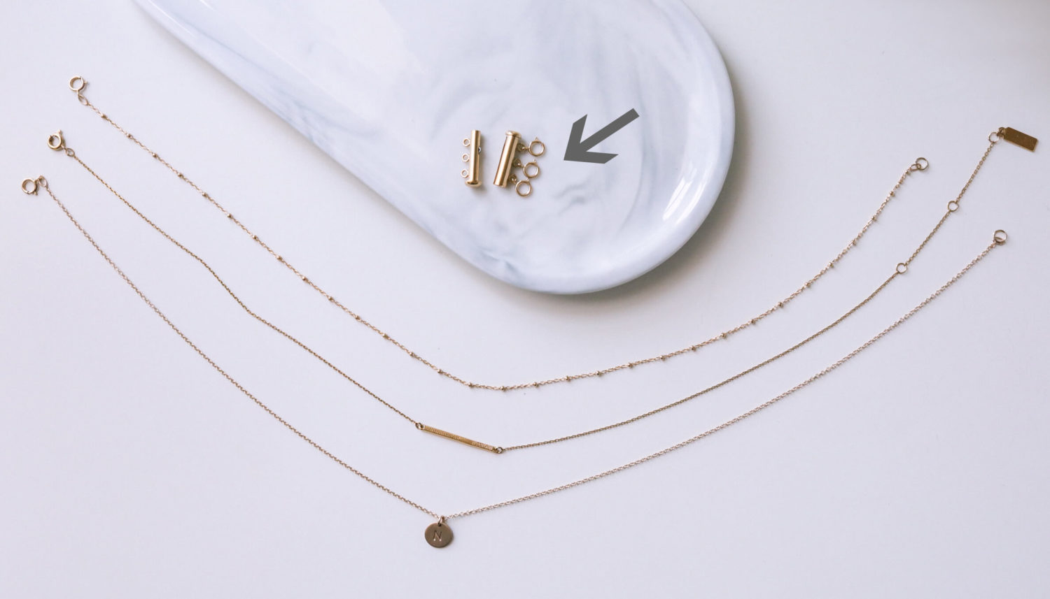 how to layer necklaces without tangling